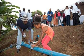 Grenada. The water from the new rainwater harvesting plant in Blaize is fit for drinking. © GIZ