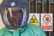 German Biosecurity Programme. Local expert in personal protective gear during a simulation exercise on biological risk situations. © GIZ