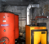 Energy-efficiency measures in the building sector. Inspection of a heating system and boiler. © GIZ