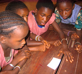 Guinea. Teaching games make learning fun in everyday schooling. Guinean girls in class. © GIZ