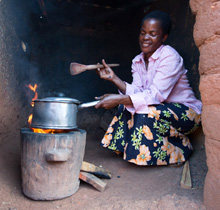 A woman cooking with an improved stoves provided through the Energizing Development Programme in Malawi. © GIZ
