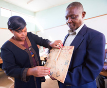 Malawi. A College Mathematics lecturer demonstrates how learners can be taught to tell time by actively engaging one of his student teachers in the process. © GIZ