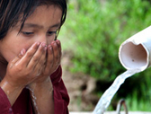 Pakistan. Young girl drinking water