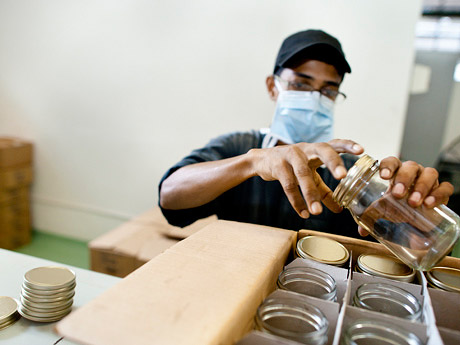 Quality control: An employee checks the jars before they are sent to the bottling plant.