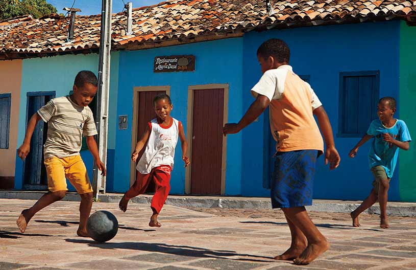 Boys playing football in the street
