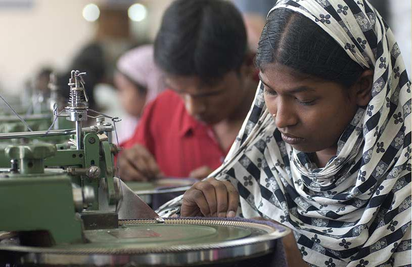 Female textile worker in Bangladesh at work.