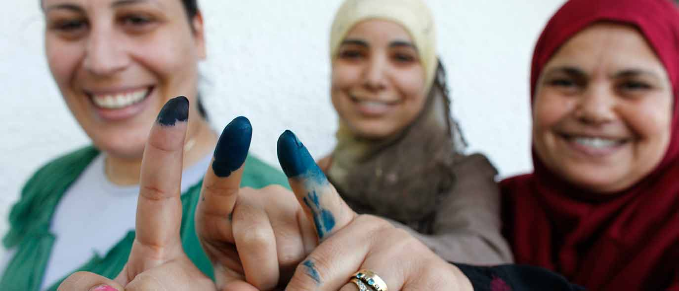Female voters showing ink mark on their fingers after voting at the 2011 national election in Tunisa